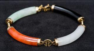 A 14K gold set jade bracelet