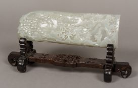 A Chinese carved celadon jade panel