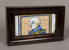 A 16th/17th century Italian Castelli faience pottery tile Decorated with a male figure before a