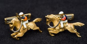 A pair of 18K gold and enamel cufflinks Each formed as a racehorse with jockey up. Each 2.