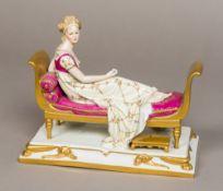 A GDR porcelain figure of Madame Recamie