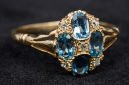 An unmarked 18 ct gold, diamond and aqua