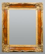 A 19th century gilt and rosewood framed wall glass The rectangular plate bevelled.