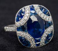 An Art Deco sapphire and diamond set platinum ring Cruciform set.
