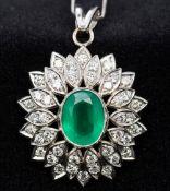 A platinum, diamond and emerald set pend