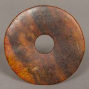 A Chinese russet jade bi disc