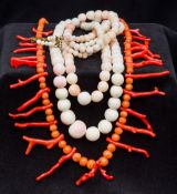A red coral bead and stick necklace