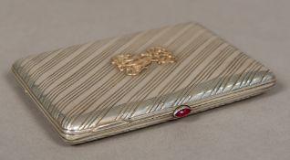 A Russian silver cigarette case, the ins