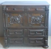 A 17th century oak two part chest of drawers The moulded rectangular top above an arrangement of