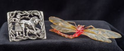 A French Art Nouveau carved horn brooch
