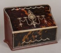 A Victorian unmarked silver and tortoiseshell mounted stationery box The hinged shaped lid inset