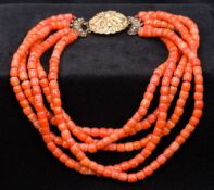 An unmarked 18 ct gold mounted coral nec