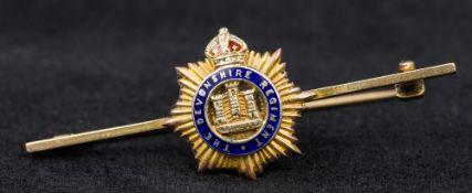 A 9 ct gold and enamel Regimental bar br