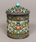 A Chinese silver and enamel clad green h