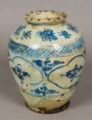 An antique Persian blue and white potter