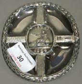 A small silver dish centred with Britannia