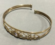 A rose gold amethyst set bangle