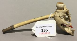 A novelty skull mounted pipe inscribed Harzburg