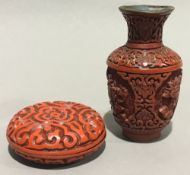 A red cinnabar lacquer box and vase