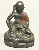 A small Chinese red painted god figure