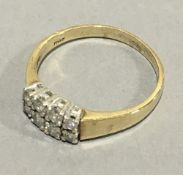 A 9 ct gold diamond set ring