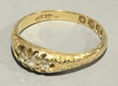 An 18 ct gold three stone diamond ring