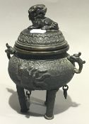 A Chinese bronze censer with dog-of-fo mounted lid