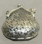 A small silver purse