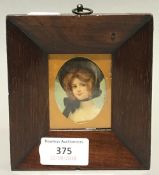 A small 19th century rosewood frame with portrait print