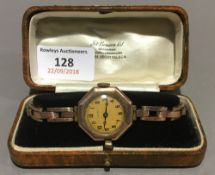 An early 20th century 9 ct gold cased lady's wristwatch, of octagonal form,