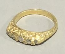 An 18 ct gold five stone diamond ring