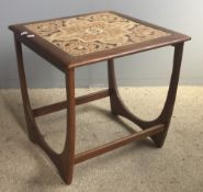 A G-Plan coffee table with tiled top