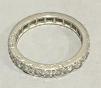 A diamond set unmarked eternity ring