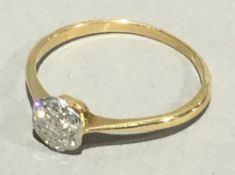 An 18 ct gold diamond daisy set ring