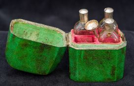 A shagreen cased set of scent bottles (three bottles and one funnel)