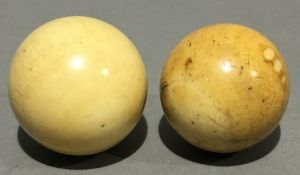 Two small 19th century ivory balls