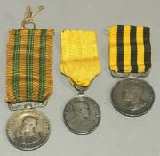 Three Eastern medals and a medallion