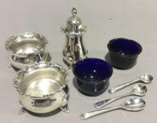 A three piece silver cruet