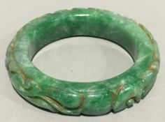 A Chinese carved jade bangle