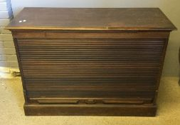 An early 20th century tambour fronted cabinet