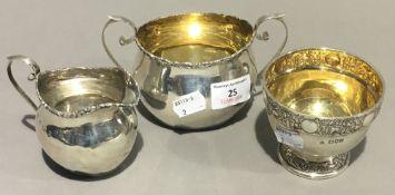 A silver cream jug,