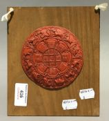 A Chinese cinnabar lacquered rounded relief decorated with animals of the New Year,