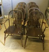 A set of eight wheel back chairs