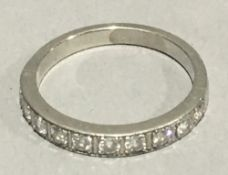 An 18 ct gold diamond half hoop eternity ring