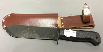 A survival knife in leather sheath, Special Forces,