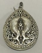 A Chinese pendant decorated with fish