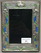 A large silver Art Nouveau style frame