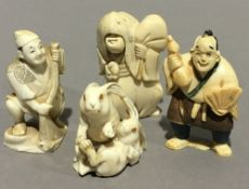 Three late 19th/early 20th century carved ivory netsuke and an ivory figure