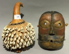 An African cowrie shell mounted gourd,