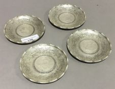 Four Chinese coin dishes